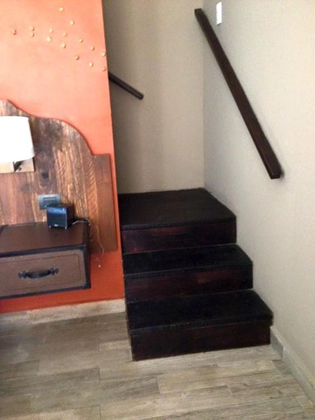 stairs behind bed
